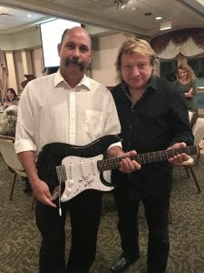 Lou Gramm with the winner of the autographed Fender guitar!